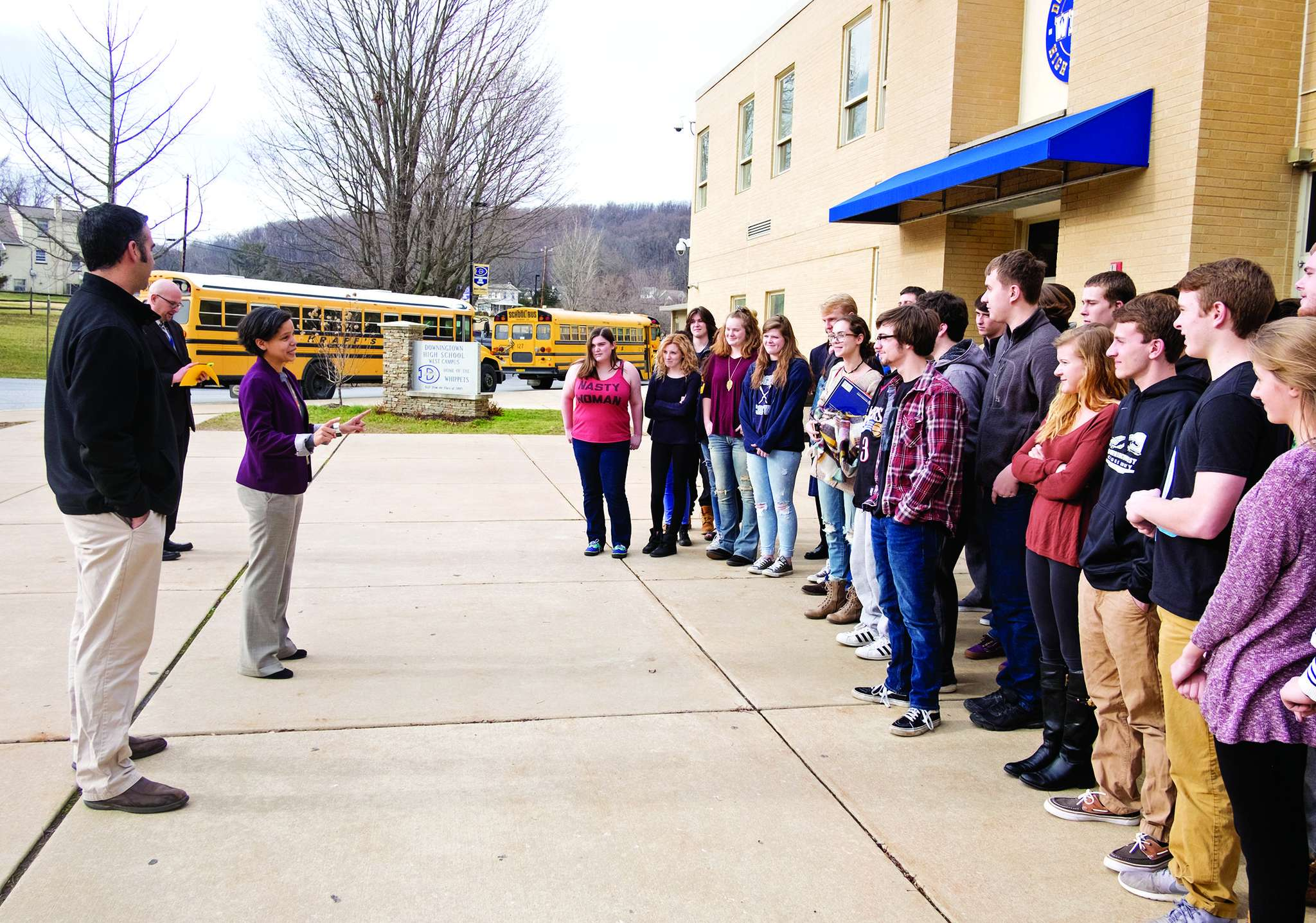 Outside Downingtown West High School , assistant principal Ilana Shipe and teacher Dan Soler brief students on their trip to the presidential inauguration in Washington. ED HILLE / Staff Photographer