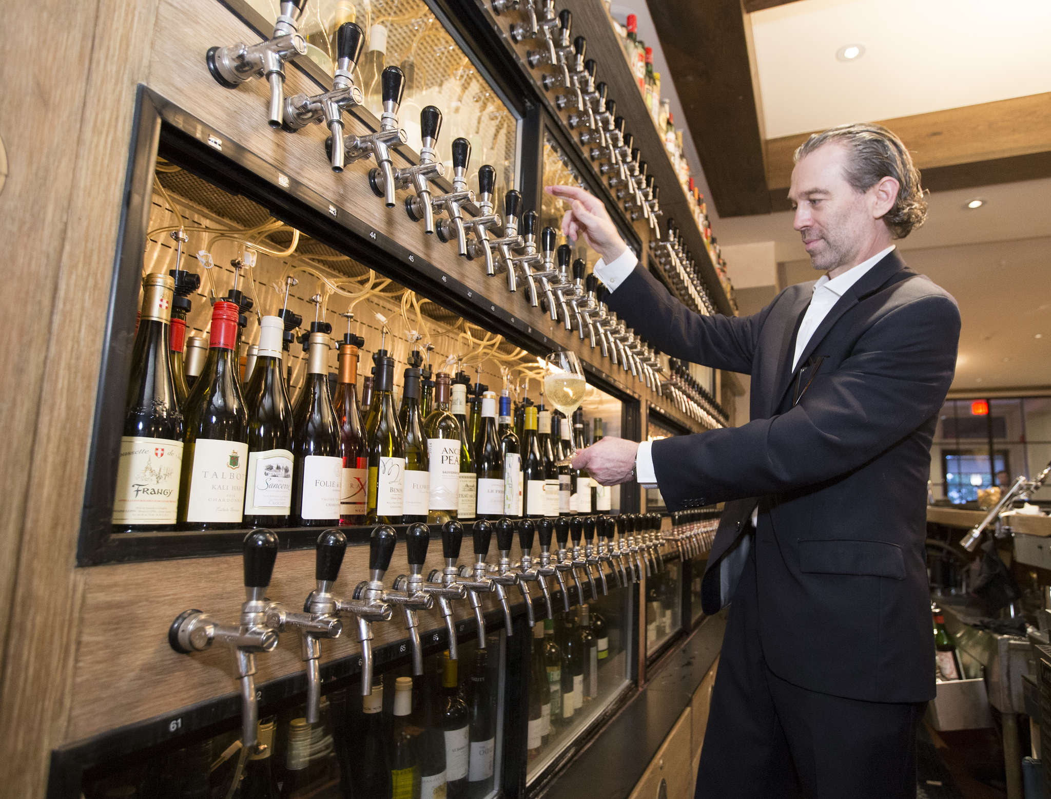William Eccleston, Panorama´s wine director and general manager, pours a glass at the 120-bottle Wine Keeper, the largest single wine-by-the-glass preservation system in the world.
