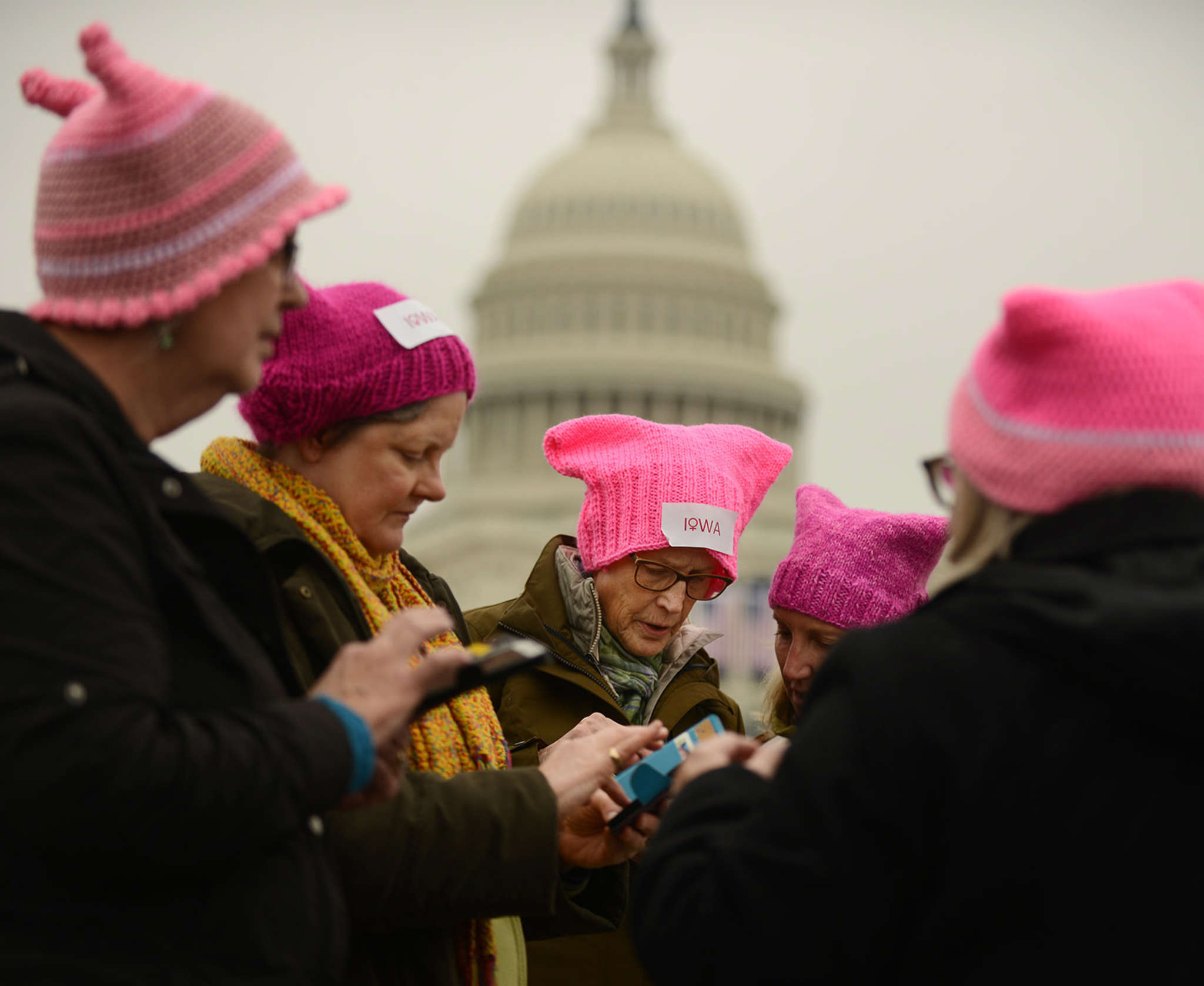 Women from Iowa in their self-made pink hats gathered near the Capitol last weekend. ASTRID RIECKEN / Washington Post