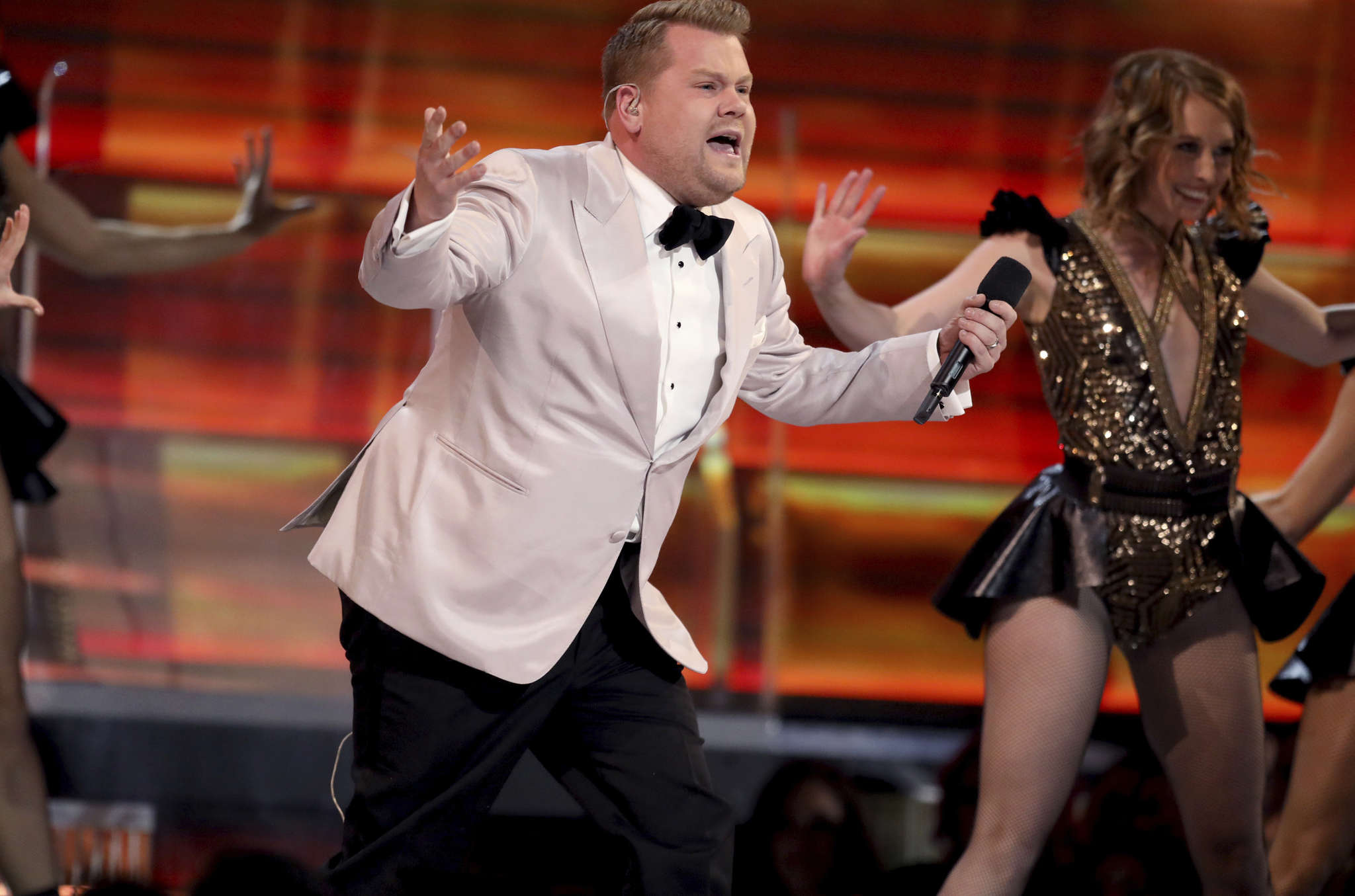 James Corden rapped, did a comic pratfall, cracked jokes about nominees, and took a political shot or two.