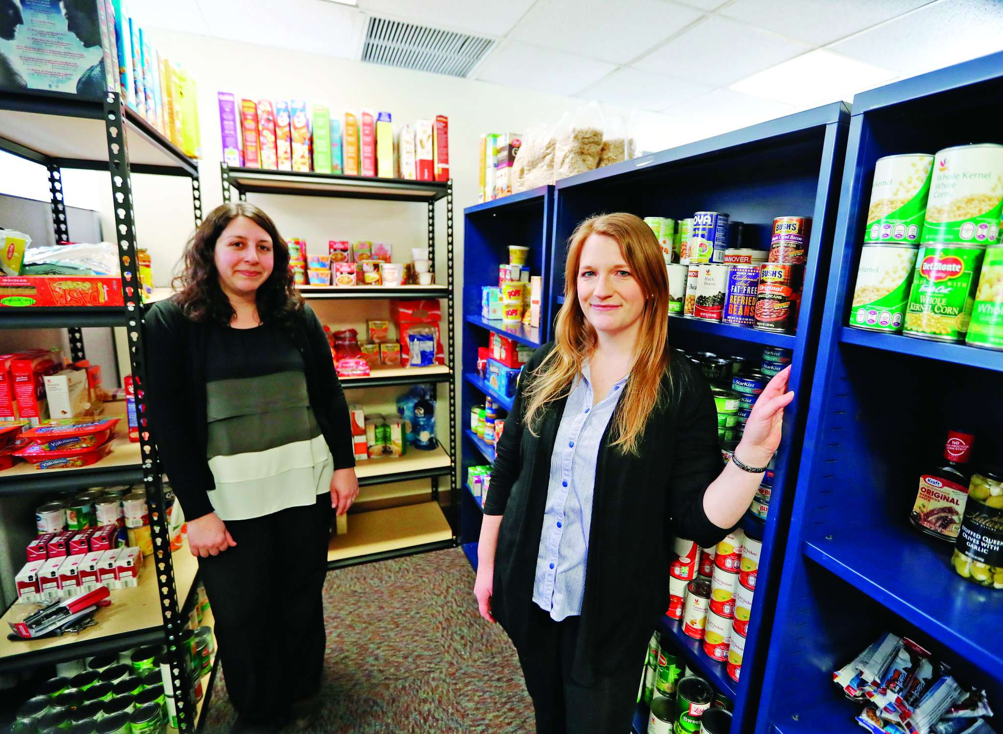 Jodi Roth-Saks (left) and Tori Nuccio in the new food pantry at West Chester University.