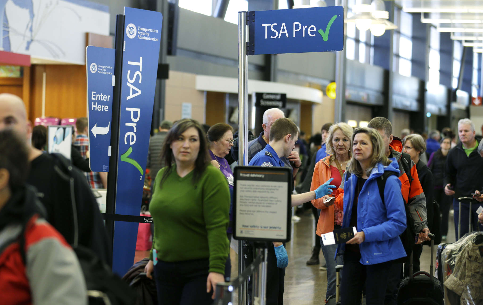 """About 9.5 million fliers have enrolled in """"trusted traveler"""" programs such as TSA PreCheck to ease waiting time at airport checkpoints."""