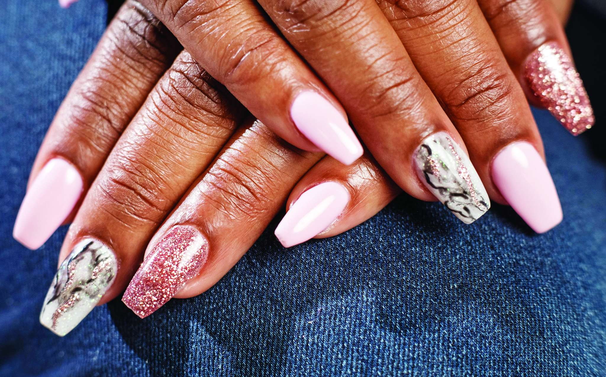 Christine Harris´ glitter-accented marble nails, courtesy of Koco Nail Salon. ED HILLE / Staff Photographer