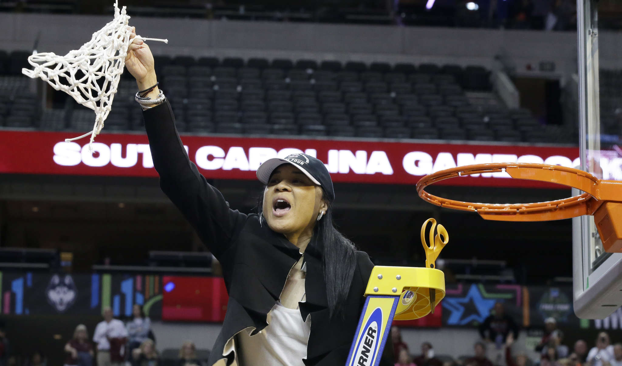 Coach Dawn Staley triumphantly holds up the net after leading the South Carolina women´s basketball team to the NCAA championship. It´s the latest achievement of a decorated career for the North Philadelphia native.