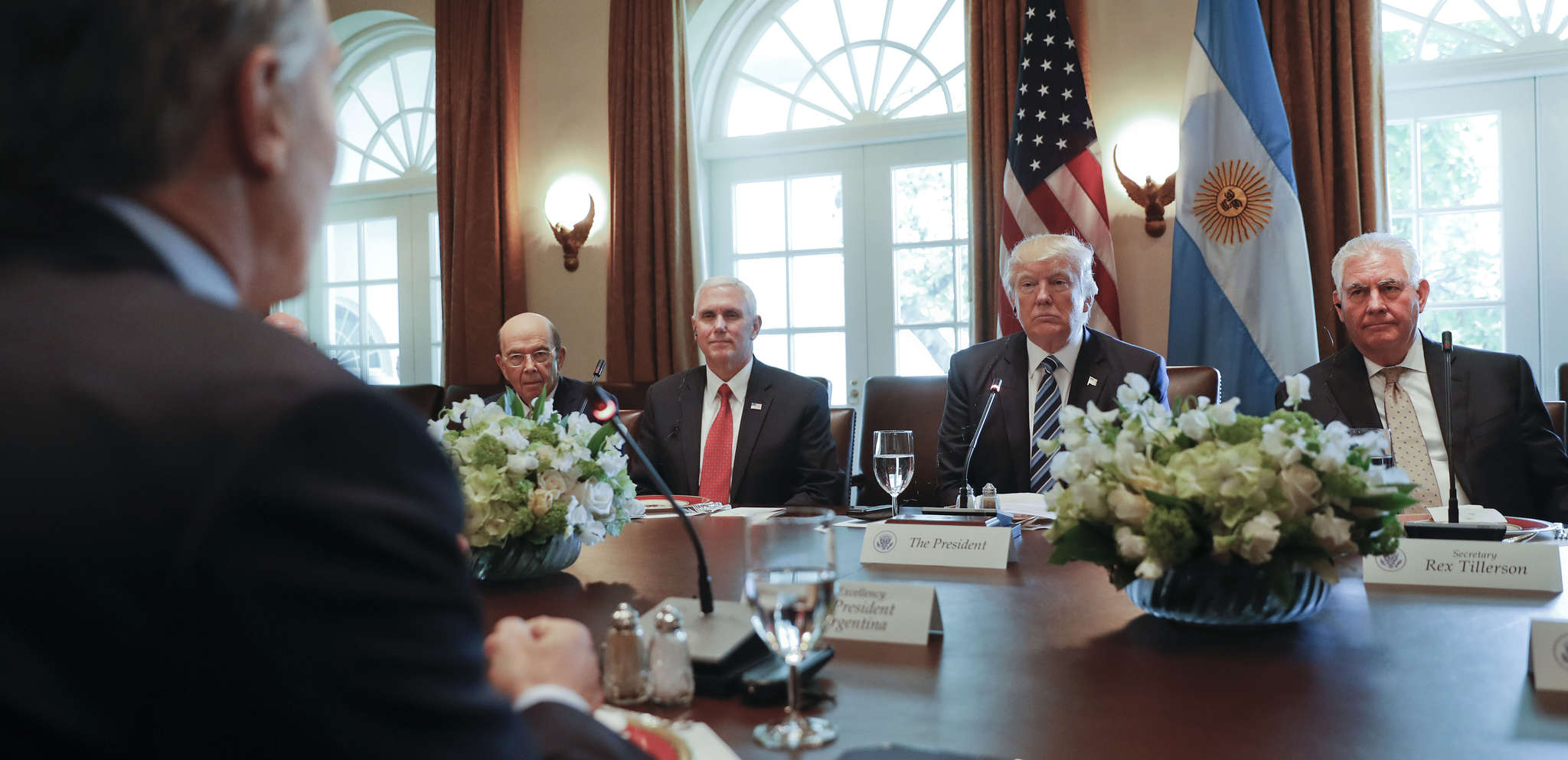 President Trump , flanked by Vice President Pence (left) and Secretary of State Rex Tillerson, listening to Argentina´s President Mauricio Macri on Thursday. At far left is Commerce Secretary Wilbur Ross. AP