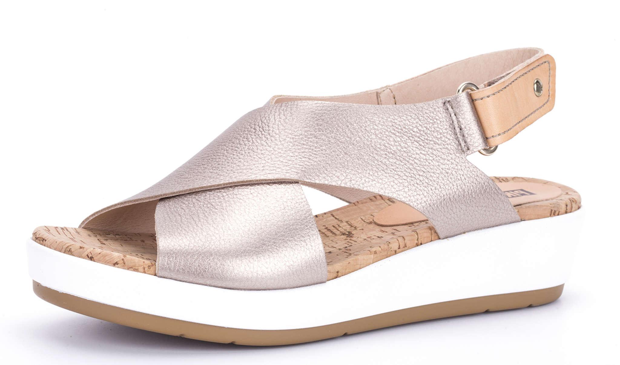 Metallic slip-ons and sneakers add glamour. Pikolinos Mykonos, $150, www.pikolinos.com