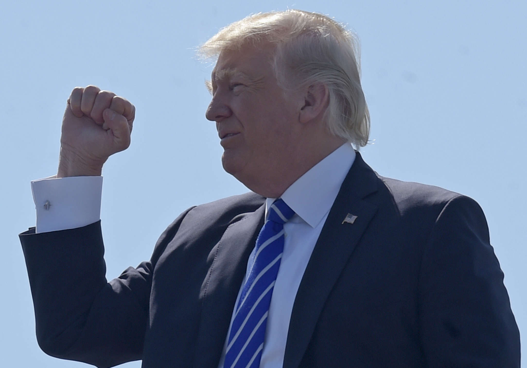 President Trump gestures at Groton-New London Airport in Connecticut, before giving the commencement address at the U.S. Coast Guard Academy on Wednesday.