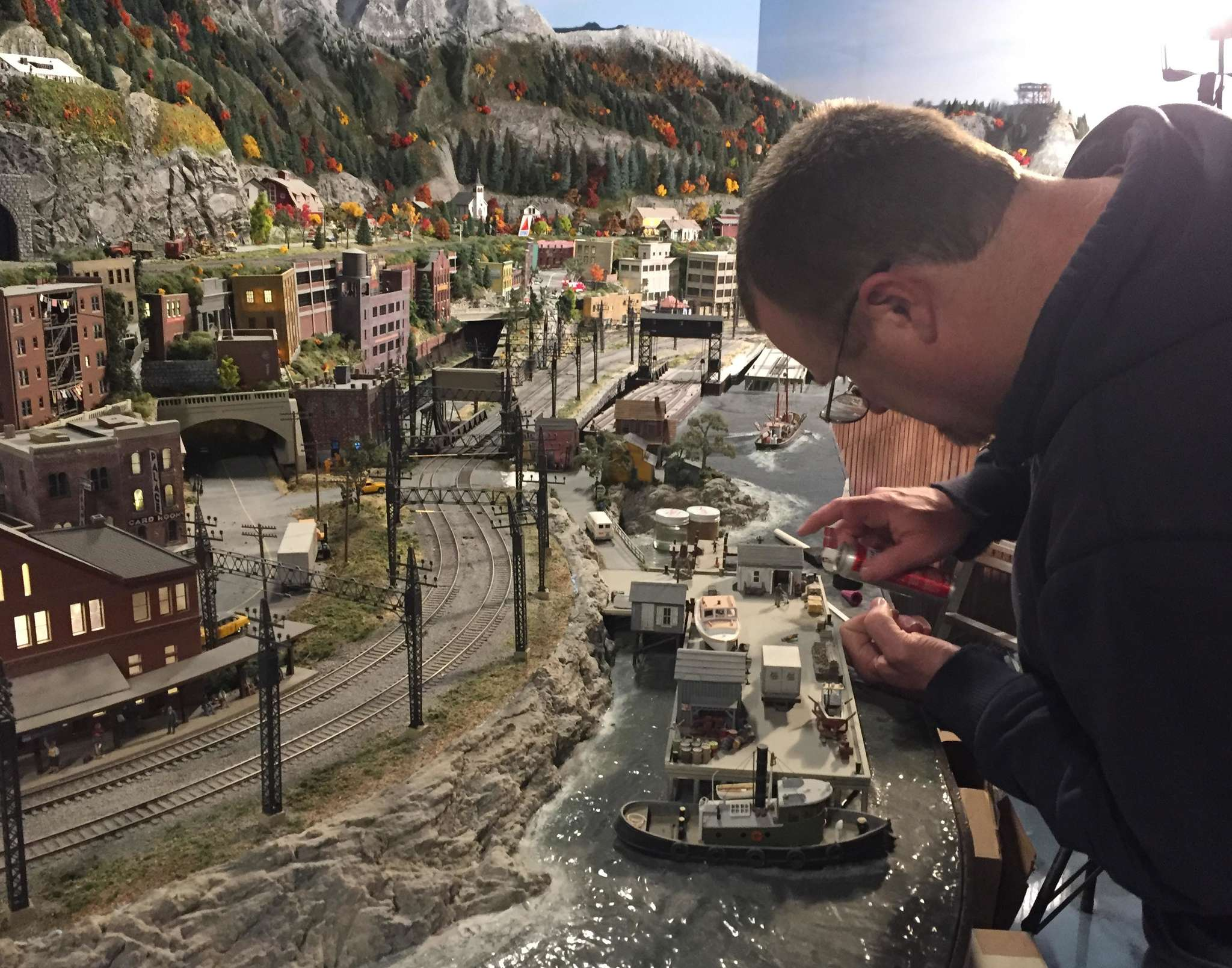 A worker puts the final touches on a New England section of Gulliver´s Gate, a miniature world in Times Square.