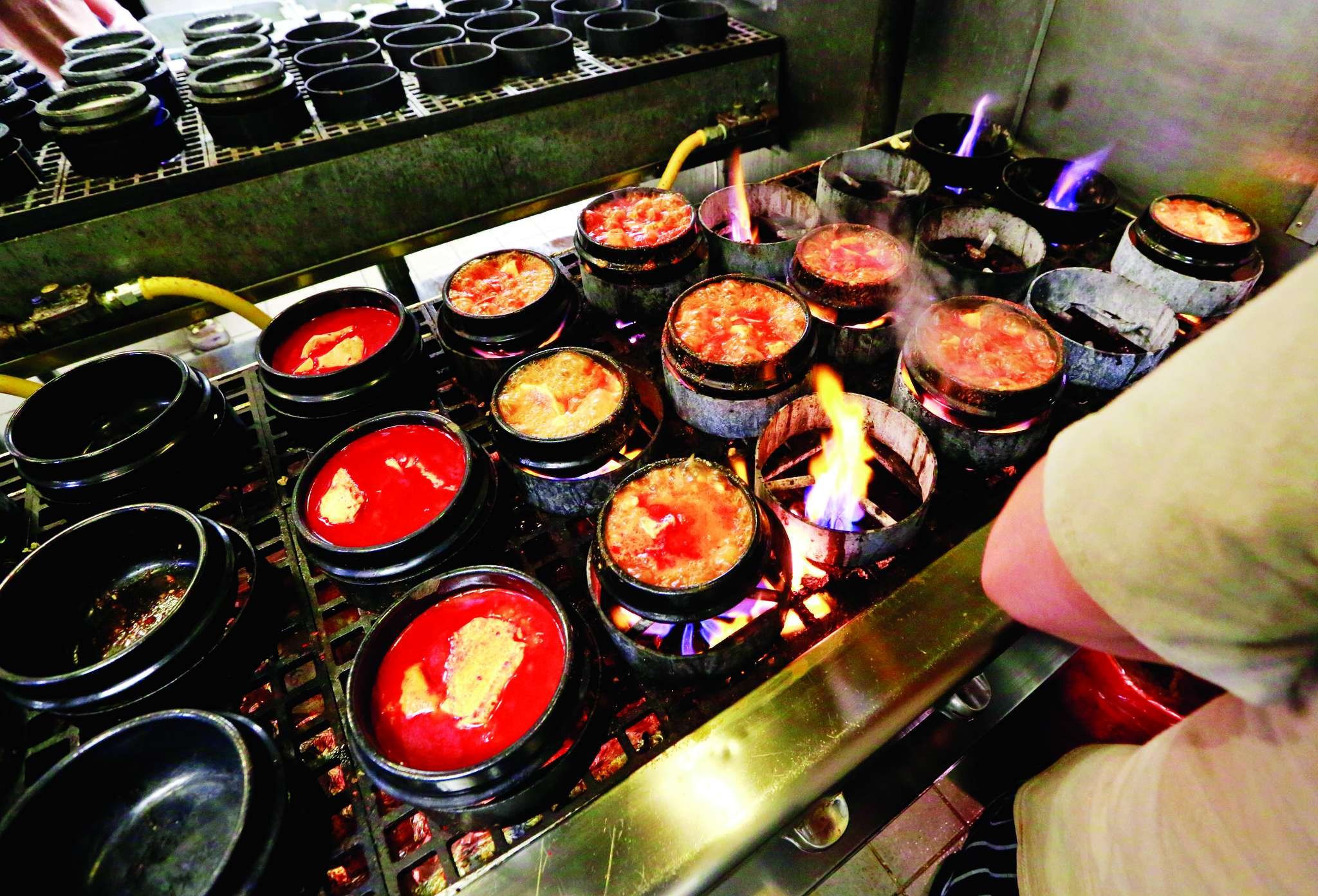 Dubu´s signature dish, soondubu, simmers in pots. The tofu stew takes several weeks to make.