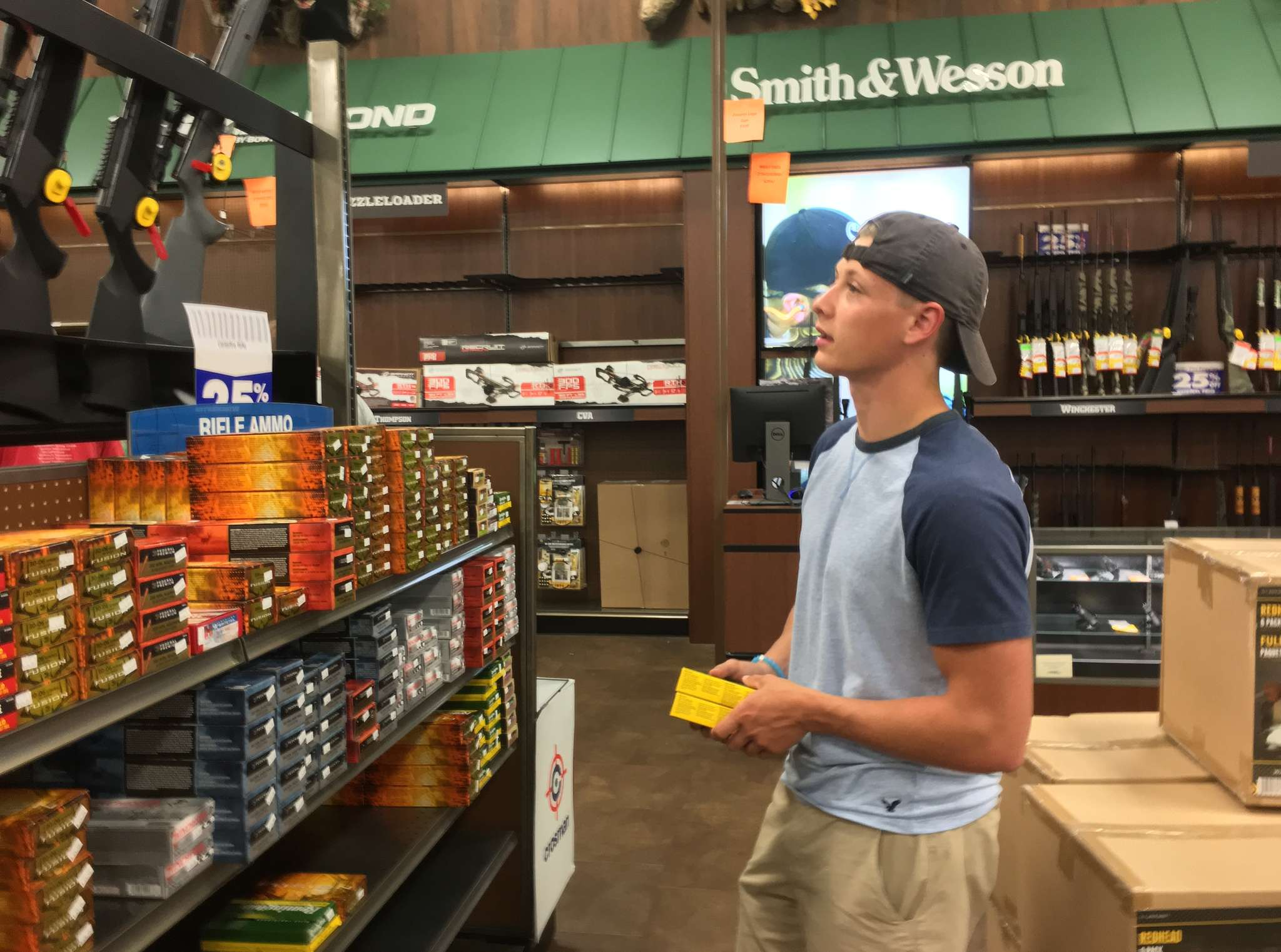 At Gander Mountain in Warrington, Tyler James, 18, shops for ammunition for his hunting rifle. SUZETTE PARMLEY / Staff