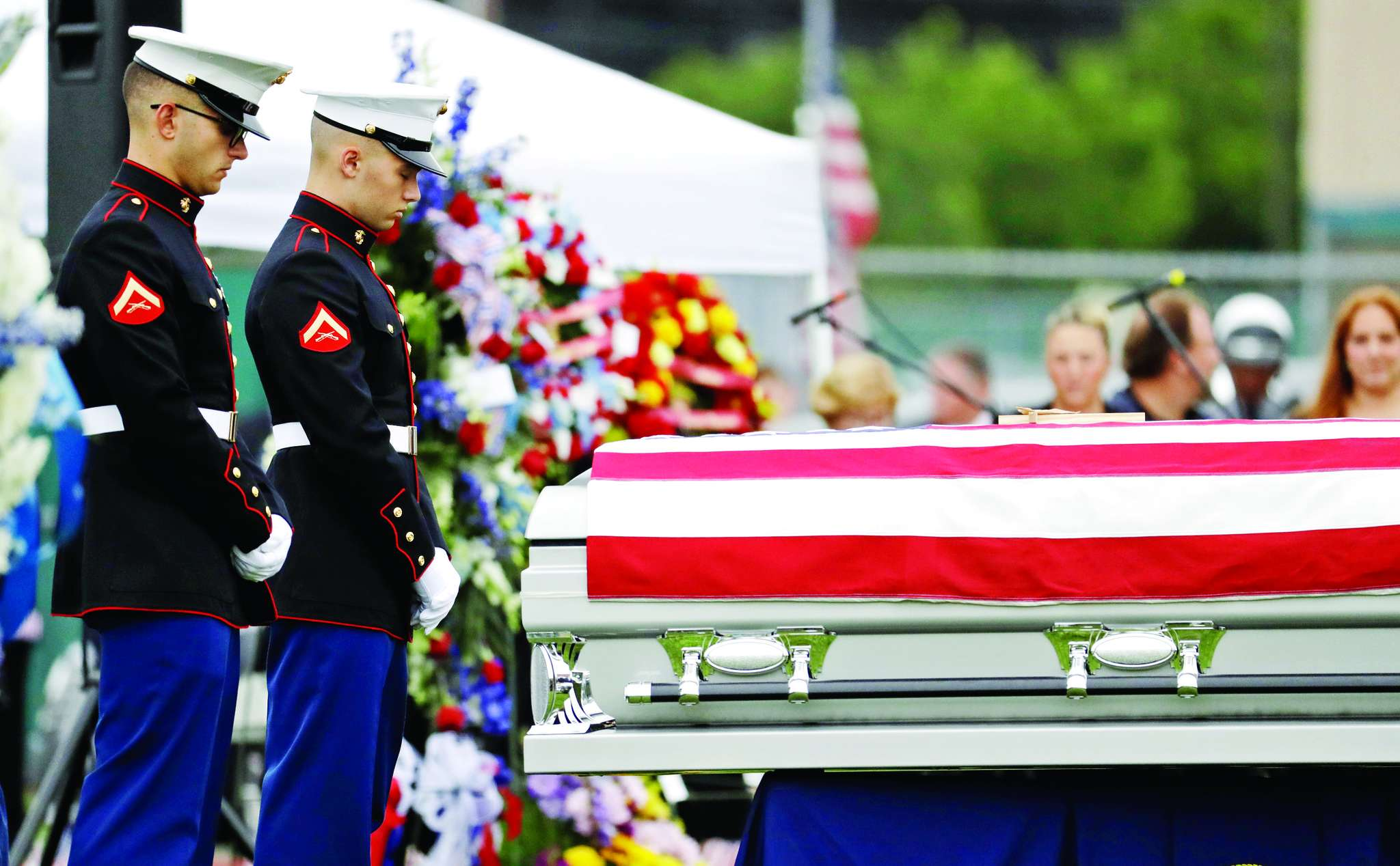 Marines stand guard next to the casket of Cpl. Dan Baldassare in Colts Neck, N.J.
