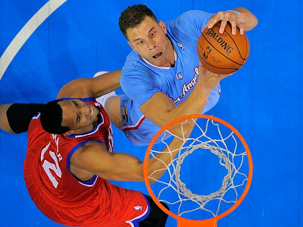 Los Angeles Clippers forward Blake Griffin, right, puts up a shot as<br />Philadelphia 76ers forward Evan Turner defends during the first half<br />of an NBA basketball game Sunday, Feb. 9, 2014, in Los Angeles. (Mark J. Terrill/AP)