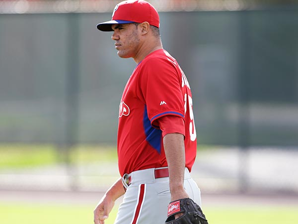 Philadelphia Phillies pitcher Alfredo Miguel Gonzalez walks to the field before a spring training baseball practice Thursday, Feb. 13, 2014, in Clearwater, Fla. (AP Photo/Charlie Neibergall)