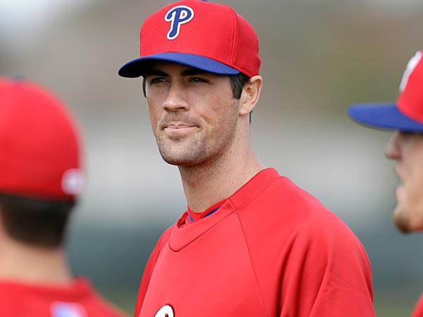 Philadelphia Phillies starting pitcher Cole Hamels, center, stands with teammates during spring training baseball practice Thursday, Feb. 13, 2014, in Clearwater, Fla. (AP Photo/Charlie Neibergall)