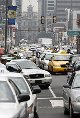 Philadelphia taxi drivers take up all lanes of Market Street near the offices of the Philadelphia Parking Authority at 3101 Market St. in University City. The drivers are protesting the increased parking ticket campaign by the PPA.