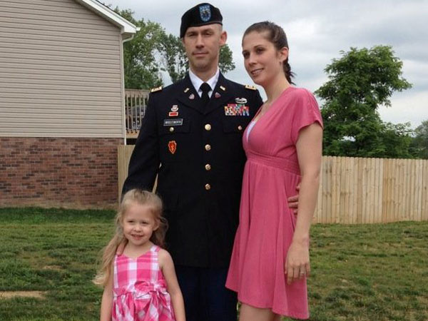 Chad, Aimee and their daughter.