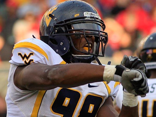 West Virginia defensive end Will Clarke in action . (AP Photo/Al Behrman)
