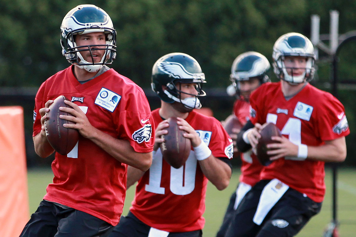 Eagles quarterbacks Sam Bradford (left), Chase Daniel (10), Carson Wentz (11) and McLeod Bethel-Thompson participate in a drill on the first day of training camp Monday, July 25, 2016.