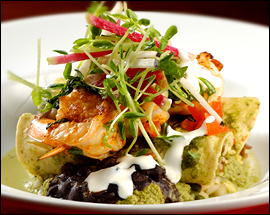 Lolita's enchiladas verdes are topped with bright tomatilla salsa and grilled shrimp.                                      (Michael S. Wirtz/Inquirer)