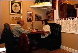 Steven Skinner and his wife Karen Skinner of Villanova enjoy a quiet dinner by the front window at Harlan´s.                                      (Photo:  Bob Williams)