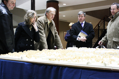 Radnor Township residents look over a model of Villanova University´s gateway project after the university presented to the Board of Commissioners Monday night. (Ashley Nguyen / Philly.com)