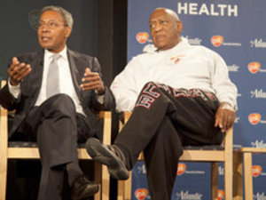Comedian Bill Cosby and Harvard psychiatrist Alvin Poussaint lead a discussion about community health on Monday. (RYAN S. GREENBERG / Staff Photographer)