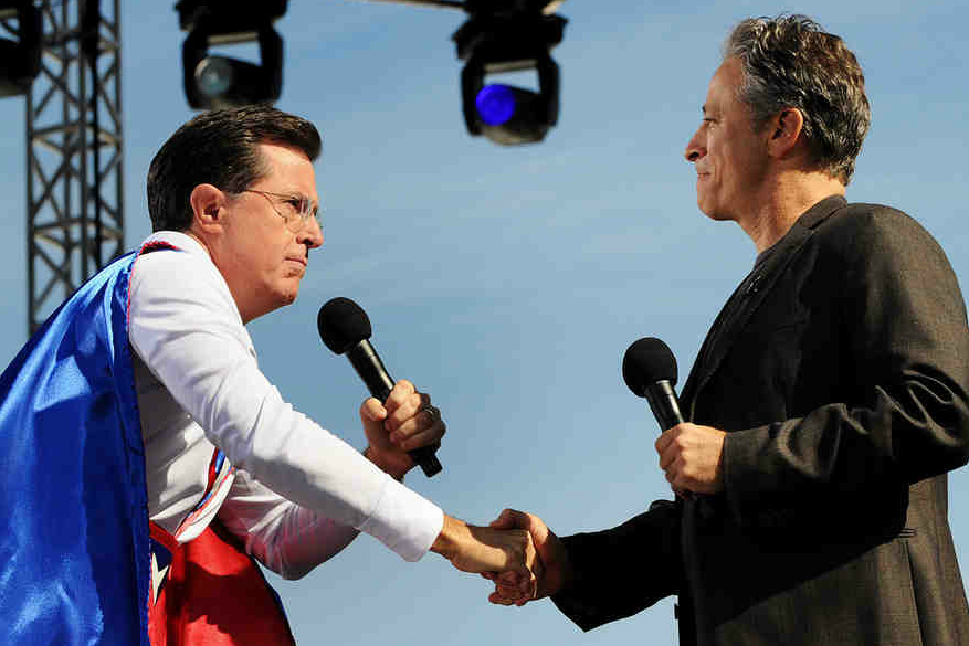 Comedians Stephen Colbert (left) and Jon Stewart draw thousands to a rally in D.C. for sanity (or fear) in 2010.