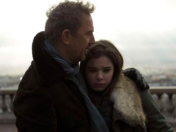 "Dad has work to do: Kevin Costner and Hailee Steinfeld share a quiet moment amid the mayhem in ""3 Days to Kill."""