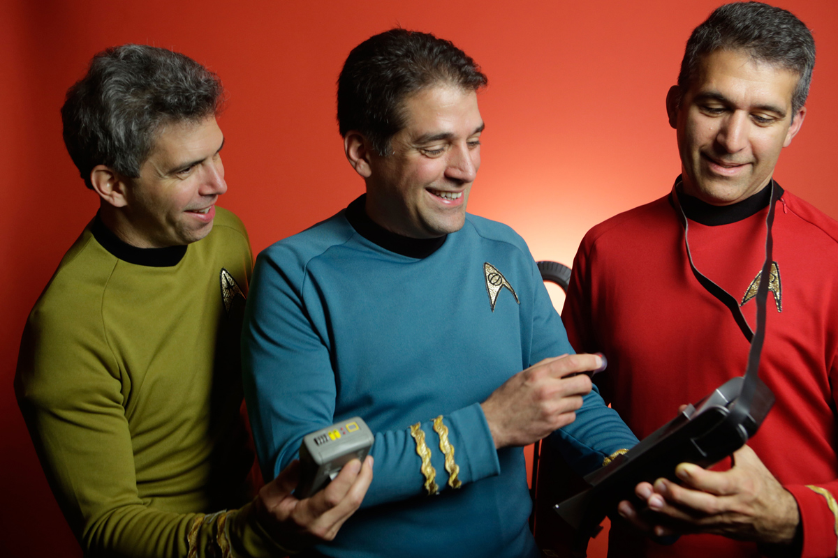Brothers George, Basil and Gus Harris examine prop tricorders from the Star Trek series; the Harris siblings named their team Final Frontier Medical Devices.