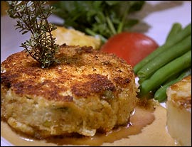 Crabcake with Thai red curry sauce is one of the few dishes bearing a modern touch.                                      (Jonathan Wilson/Inquirer Staff Photographer)