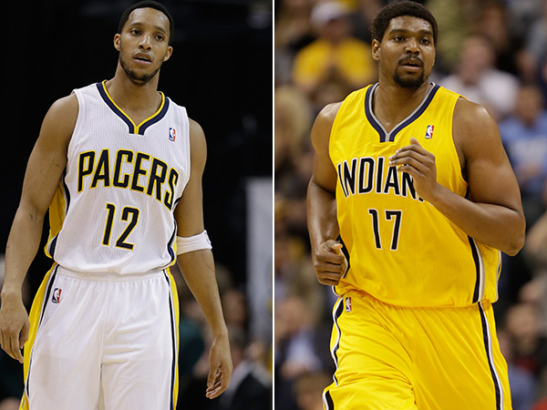 Evan Turner and Andrew Bynum. (AP Photos)