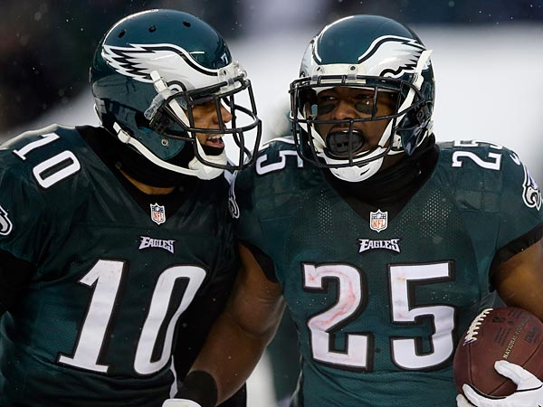 Philadelphia Eagles´ LeSean McCoy and DeSean Jackson are seen during an NFL football game against the Detroit Lions on Sunday, Dec. 8, 2013, in Philadelphia. Philadelphia won 34-20. (AP Photo/Michael Perez)