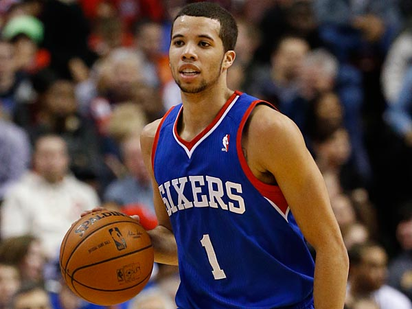 Michael Carter-Williams in action against the Pistons. (AP Photo/Matt Slocum)