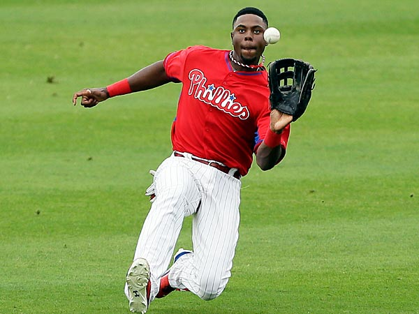 Philadelphia Phillies center fielder John Mayberry Jr. catches a fly<br />ball hit by New York Yankees&acute; Brett Gardner during the fourth inning<br />of an exhibition baseball game Thursday, March 6, 2014, in Clearwater,<br />Fla. (AP Photo/Charlie Neibergall)
