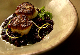 Seared scallops over lentils get a sweet lift from diced beets.                                      (Michael Perez/Inquirer)