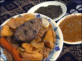 Thiebou dieun (left) combines jolof rice, one of Senegal´s most famous dishes, with steamed fish, chunks of stewed vegetables and a tangy cassava leaf sauce (center). Mafe (right), a peanut butter stew, is served with mutton or alone as a sauce.                                      John Costello / Inquirer