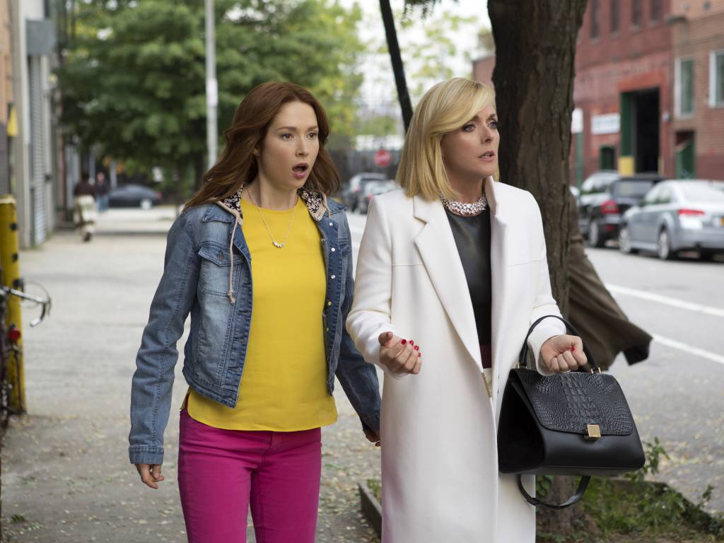"In this image released by Netflix, Ellie Kemper, left, and Jane Krakowski appear in a scene from ""Unbreakable Kimmy Schmidt,"" an original series on Netflix. (AP Photo/Netflix)"