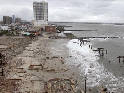 Foundations and pilings are all that remain of brick buildings and part of the boardwalk in Atlantic City after they were destroyed by Tropical Storm Sandy. (AP Photo / Seth Wenig)