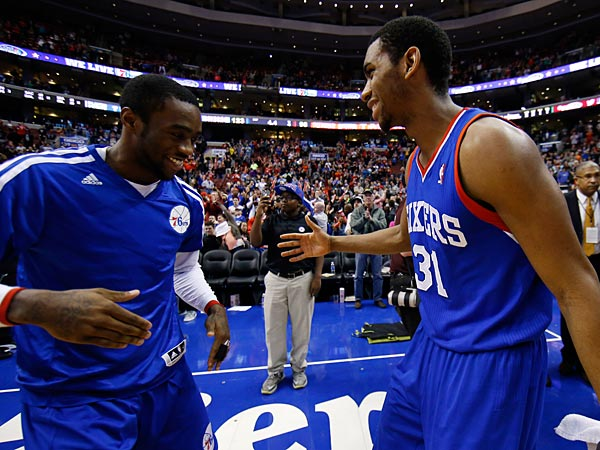 Philadelphia 76ers´ Tony Wroten, left, and Hollis Thompson celebrate after an NBA basketball game against the Detroit Pistons, Saturday, March 29, 2014, in Philadelphia. Philadelphia won 123-98, breaking a 26-game losing streak. (AP Photo/Matt Slocum)