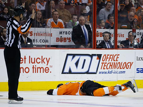 Steve Downie lies on the ice after an injury during an NHL hockey game against the St. Louis Blues, Saturday, March 22, 2014, in Philadelphia. (AP Photo/Matt Slocum)