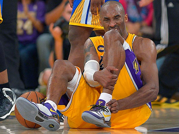 Los Angeles Lakers guard Kobe Bryant grimaces after being injured<br />during the second half of their NBA basketball game against the Golden<br />State Warriors, Friday, April 12, 2013, in Los Angeles. The Lakers won<br />118-116. (AP Photo/Mark J. Terrill)