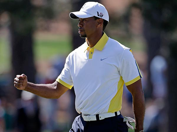 Tiger Woods pumps his fist after a birdie on the seventh hole during<br />the second round of the Masters golf tournament Friday, April 12,<br />2013, in Augusta, Ga. (AP Photo/Darron Cummings)