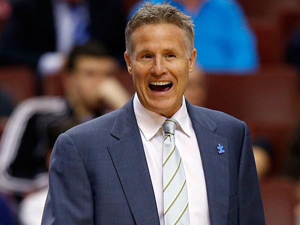 Sixers Head Coach Brett Brown laughs against the Charlotte Bobcats on<br />Wednesday, April 2, 2014.  ( Yong Kim / Staff Photographer )