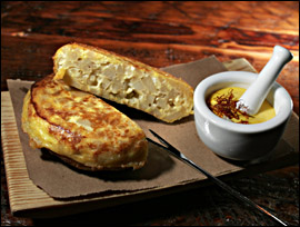 The tortilla Espanola, a dish usually served cold, arrives hot at Amada, with saffron aioli.