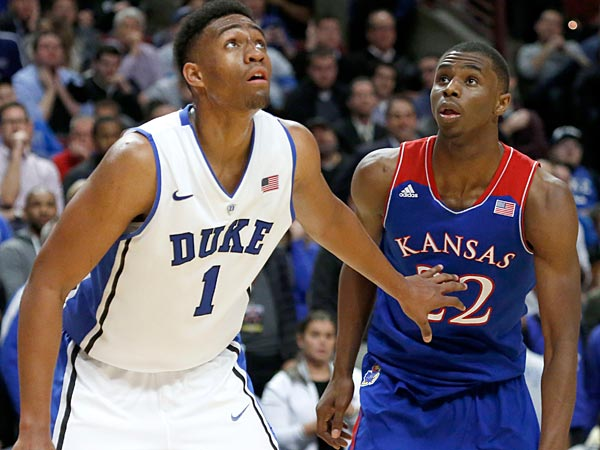 Duke forward Jabari Parker and Kansas guard Andrew Wiggins look for a possible rebound off a free-throw attempt during the second half of an NCAA college basketball game Tuesday, Nov. 12, 2013, in Chicago. Kansas won 94-83. (AP Photo/Charles Rex Arbogast)