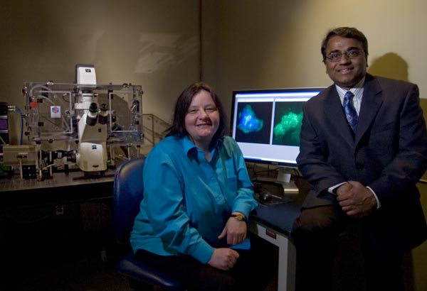 Doctors Sigrid A. (left) and Ayyappan K. Rajasekaran, with the Nemours Center for Childhood Cancer Research in Wilmington (he´s the director) sit in a high tech lab with a new, unique high-resolution microscope (left) that studies cell surfaces.  On the computer monitor are images of cells that are being studied/researched into how best to avoid cancer cell migration and metastasis.  ( Clem Murray / Staff Photographer )