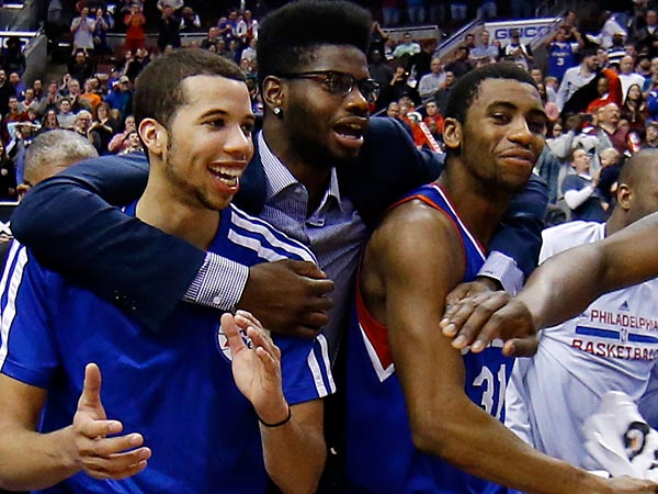From left to right, Philadelphia 76ers´ Michael Carter-Williams, Nerlens Noel and Hollis Thompson. (AP Photo/Matt Slocum)