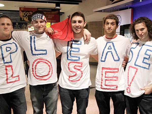 (L-R) Joe Thornton of Ocean City, NJ, Matthew Sullivan of<br />Williamstown, Matt Kline of Monroe Twp., Joe Santone of Berlin and<br />Nick Davis of Williamstown wore t-shirts that spelled &quot;PLEASE LOSE&quot; to<br />the Detroit Pistons at Sixers basketball game on March 29, 2014. <br />Sixers won 123-98. ( ELIZABETH ROBERTSON / Staff Photographer )