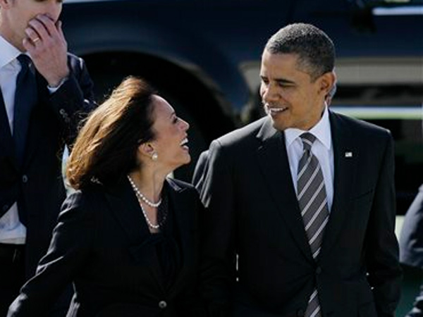 "FILE -- in this Feb. 16, 2012 file photo President Barack Obama walks with California Attorney General Kamala Harris after arriving at San Francisco International Airport in San Francisco. Obama praised Harris for more than her smarts and toughness at a Democratic Party event Thursday, April 4, 2013. The president also commended Harris for being ""the best-looking attorney general"" during a Democratic fundraising lunch in the Silicon Valley. (AP Photo / Eric Risberg, File)"