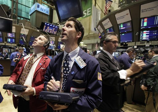 Traders work on the floor of the New York Stock Exchange Friday, May 7, 2010. (AP Photo/Richard Drew)<br />